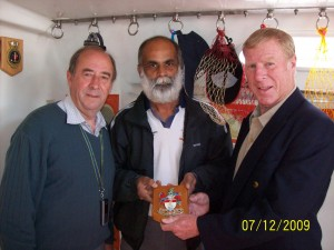 Captains Peter Rae and Geoff Swallow with Commander Dilip Donde